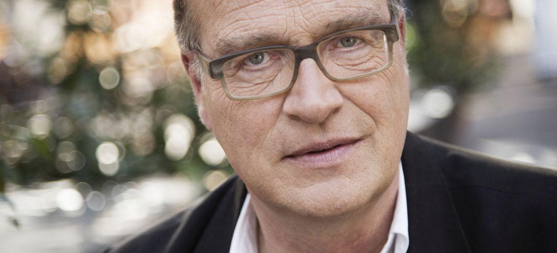 Das Foto zeigt ein Porträt von Joachim Lux.