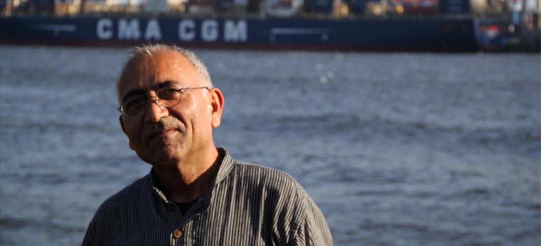 Das Foto zeigt ein Porträt von Ali Fathi.